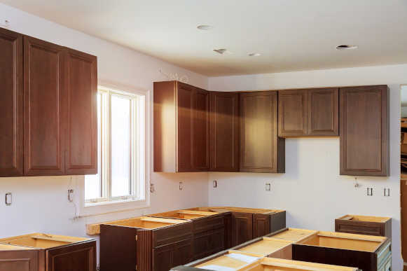 Kitchen remodel furniture installation accessories and tools adjustment on kitchen cabinets